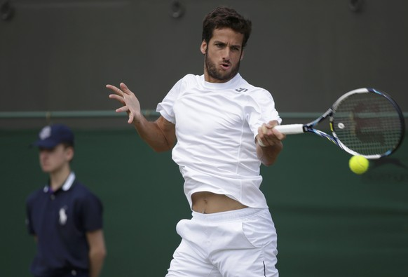 Feliciano Lopez of Spain hits a return to John Isner of the U.S. during their men's singles tennis match at the Wimbledon Tennis Championships, in London June 30, 2014.      REUTERS/Max Rossi (BRITAIN  - Tags: SPORT TENNIS)