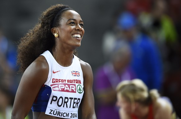 Great Britain's Tiffany Porter reacts after the Women's 100m hurdles semi-final during the European Athletics Championships at the Letzigrund stadium in Zurich on August 12, 2014.  AFP PHOTO / FRANCK FIFE