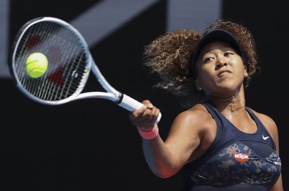 Japan's Naomi Osaka hits a forehand return to Taiwan's Hsieh Su-wei during their quarterfinal match at the Australian Open tennis championship in Melbourne, Australia, Tuesday, Feb. 16, 2021.(AP Photo/Hamish Blair)