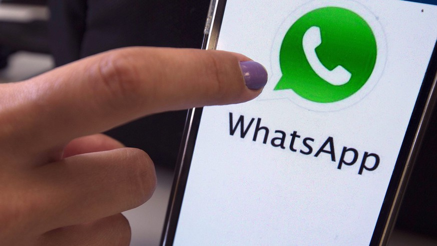 epa05432190 A photo made available 19 July 2016 shows a mobile phone featuring the WhatsApp messenger application, in Sao Paulo, Brazil, 17 December 2015. Reports on 19 July 2016 state that a judge in Brazil has ordered Brazilian mobile phone carriers to block the free messenger application WhatsApp, which is owned by Facebook, the third such ban in eight months. The ban has reportedly been imposed because of Facebook's alleged refusal to share private user information with Brazilian authorities for a police investigation.  EPA/MARCELO SAYAO