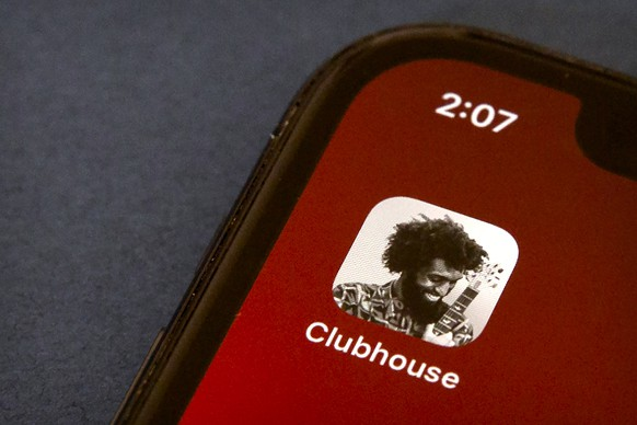 FILE - In this Feb. 9, 2021 file photo, the icon for the social media app Clubhouse is seen on a smartphone screen in Beijing. Oman has severed access to the buzzy new audio chat app Clubhouse, the country