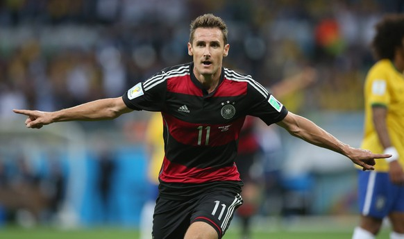 epa05612557 (FILES) A file picture dated 08 July 2014 of Germany's Miroslav Klose celebrating after scoring the second goal for his team during the FIFA World Cup 2014 semi final match between Brazil and Germany at the Estadio Mineirao in Belo Horizonte, Brazil. 38-year-old Miroslav Klose announced the end of his playing career on 01 November 2016.      (RESTRICTIONS APPLY: Editorial Use Only, not used in association with any commercial entity - Images must not be used in any form of alert service or push service of any kind including via mobile alert services, downloads to mobile devices or MMS messaging - Images must appear as still images and must not emulate match action video footage - No alteration is made to, and no text or image is superimposed over, any published image which: (a) intentionally obscures or removes a sponsor identification image; or (b) adds or overlays the commercial identification of any third party which is not officially associated with the FIFA World Cup)  EPA/Fernando Bizerra Jr.   EDITORIAL USE ONLY *** Local Caption *** 51470670