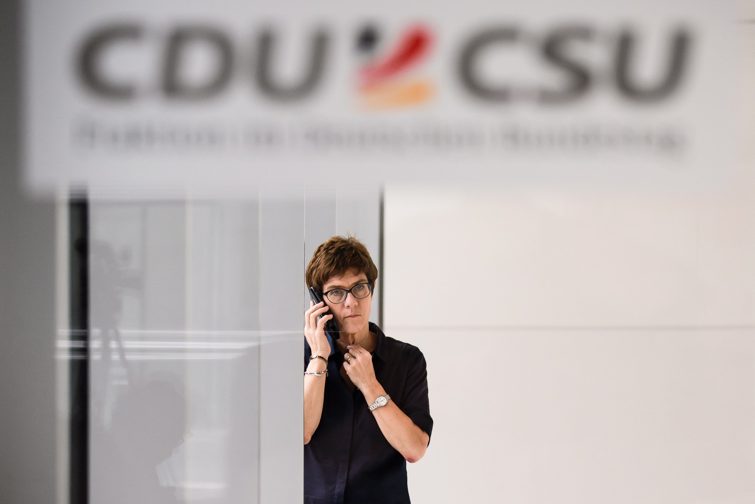 epa07129031 (FILE) - The Secretary General of the Christian Democratic Union (CDU) Annegret Kramp-Karrenbauer talks on the phone prior to a faction meeting of CDU and CSU at the German parliament in Berlin, Germany, 02 July 2018 (reissued 29 October 2018). According to reports from 29 October 2018, Kramp-Karrenbauer said she would run as candidate for CDU chairwoman to succeed Chancellor Merkel in that office.  EPA/CLEMENS BILAN