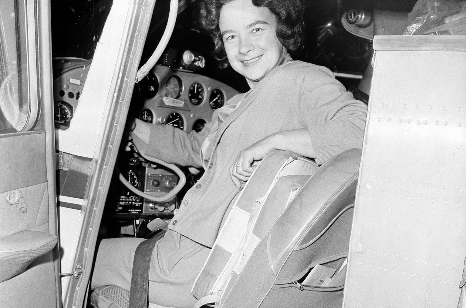 Jerrie Mock, Columbus, Ohio housewife who began her 'round-the-world flight on March 19, 1964, is shown with her plane, the Spirit of Columbus, prior to take-off. Mrs. Mock is piloting the single-engine propeller craft in an attempt to be the first woman to make a solo flight around the globe. (AP Photo/Gene Smith)