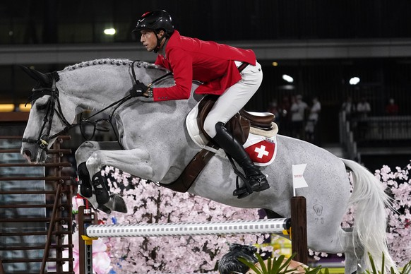 Switzerland's Martin Fuchs, riding Clooney 51, competes during the equestrian jumping individual qualifying at Equestrian Park in Tokyo at the 2020 Summer Olympics, Tuesday, Aug. 3, 2021, in Tokyo, Japan. (AP Photo/Carolyn Kaster) Martin Fuchs