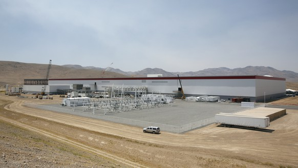 FILE - This July 26, 2016, file photo shows an overall view of the Tesla Gigafactory in Sparks, Nev. Egor Kriuchkov, a Russian citizen accused of offering a Tesla employee $1 million to enable a ransomware attack at the electric car company