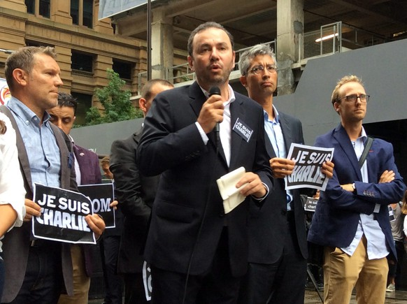 epa04554457 French ambassador to Australia, Christophe Lecourtier, speaks during a solidarity rally for the Paris terror attacks in Martin Place, Sydney, 11 January 2015.  Three days of terror that ended on 10 January saw 17 people killed in attacks that began with gunmen invading French satirical magazine Charlie Hebdo and continued with the shooting of a policewoman and the siege of a Jewish supermarket.  EPA/JENNY COCKERELL AUSTRALIA AND NEW ZEALAND OUT