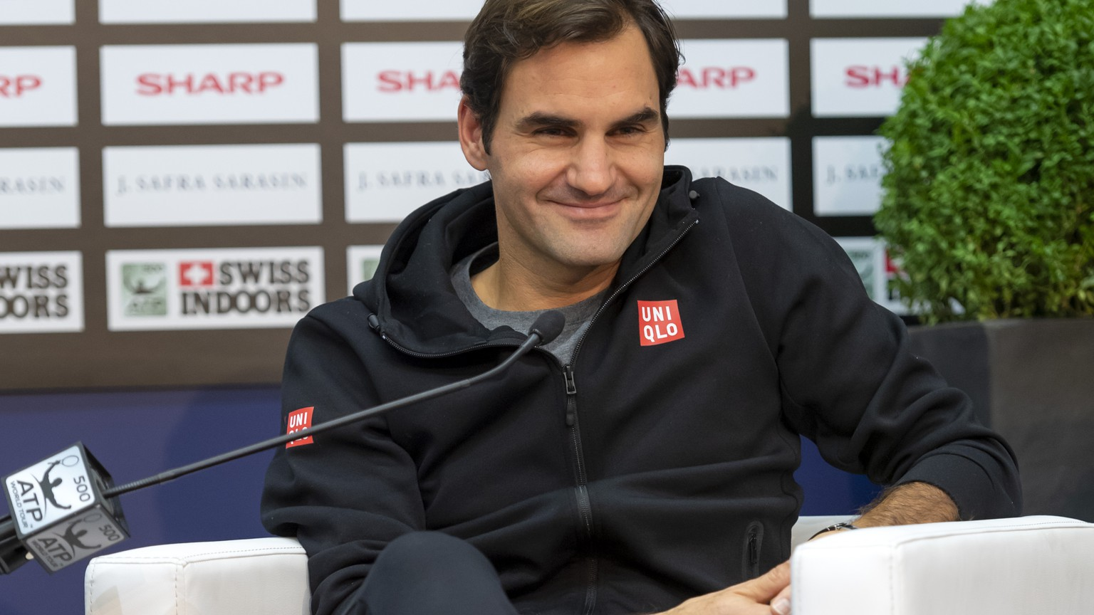 Switzerland's Roger Federer smiles during a press conference at the Swiss Indoors tennis tournament at the St. Jakobshalle in Basel, Switzerland, on Sunday, October 21, 2018. (KEYSTONE/Georgios Kefalas)
