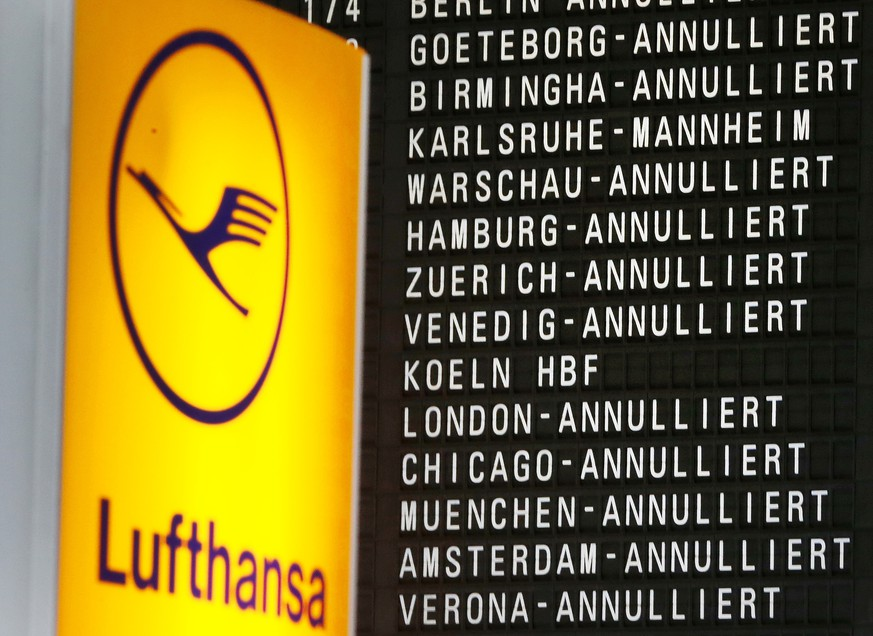Cancelled flights appear on a board when German ver.di union went on a warning strike at German airports in Frankfurt, Germany, Wednesday, April 27, 2016. (AP Photo/Michael Probst)