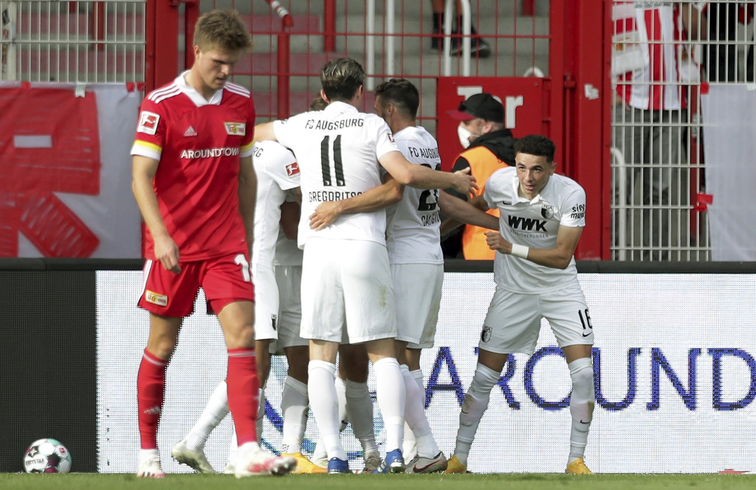 Augsburg's scorer Ruben Vargas, right, and his teammates celebrate the opening goal during the German Bundesliga soccer match between 1. FC Union Berlin and FC Augsburg in Berlin, Germany, Saturday, Sept. 19, 2020. (AP Photo/Michael Sohn)