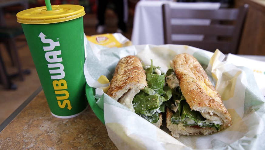FILE - In this Friday, Feb. 23, 2018 file photo, the Subway logo is seen on a soft drink cup next to a sandwich at a restaurant in Londonderry, N.H.. Ireland