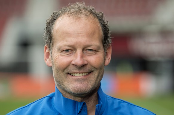 """FILE - A Tuesday, June 3, 2014 file photo of then assistant coach of the Netherlands soccer team Danny Blind prior to a training session at AFAS Stadium in Alkmaar, Netherlands. The Dutch football association appointed Danny Blind as the Netherlands' national coach, Wednesday July 1, 2015, replacing Guus Hiddink, whose contract was terminated Monday. Blind, who was an assistant to Hiddink and his predecessor Louis van Gaal, signed a contract until August 2018, with an """"evaluation moment"""" planned at the end of the 2015-2016 season. (AP Photo/Ermindo Armino, File)"""