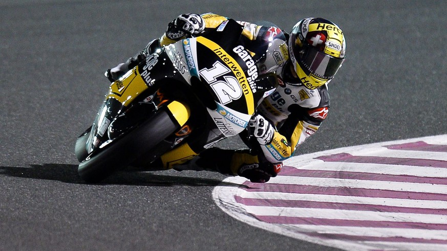 CORRECTS NAME epa05218934 Swiss Moto2 rider Thomas Luethi of the Garage Plus Interwetten team in action during a free practice session second day for the Motorcycling Grand Prix of Qatar at Al Losail International Circuit in Doha, Qatar, 18 March 2016. The 2016 MotoGP World Championship season's first race will be held in Doha on 20 March.  EPA/-