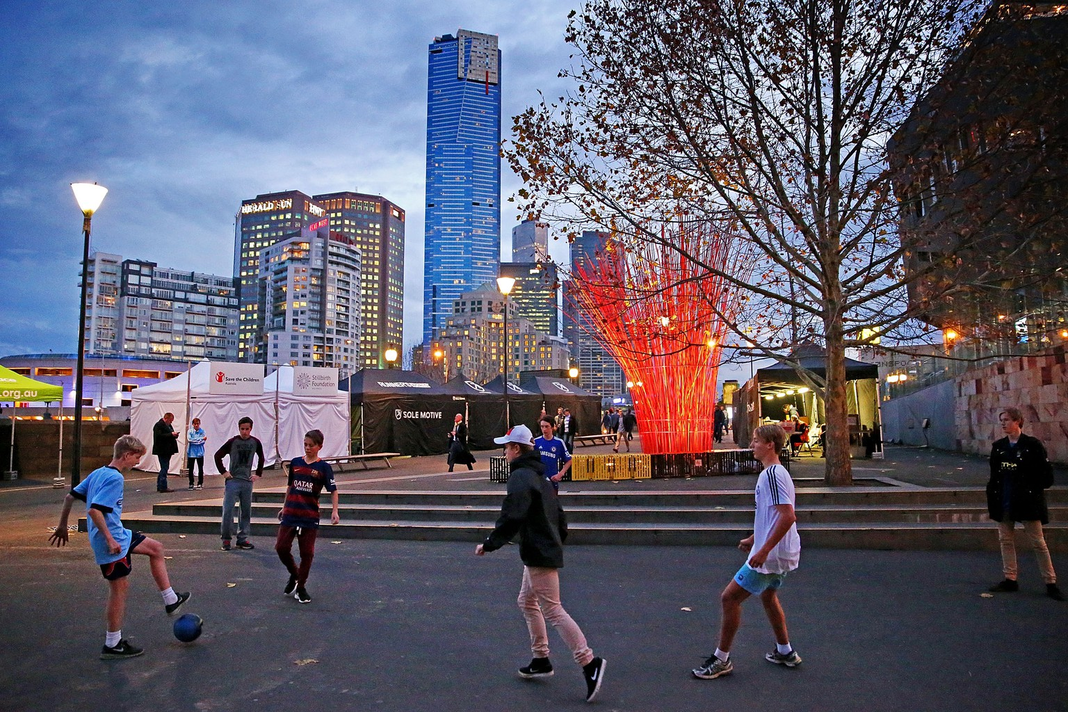 MELBOURNE, AUSTRALIA - JULY 24:  Children play football in the street as they make their way to the MCG to attend the International Champions Cup match between Real Madrid and Manchester City at the Melbourne Cricket Ground on July 24, 2015 in Melbourne, Australia.  (Photo by Scott Barbour/Getty Images)