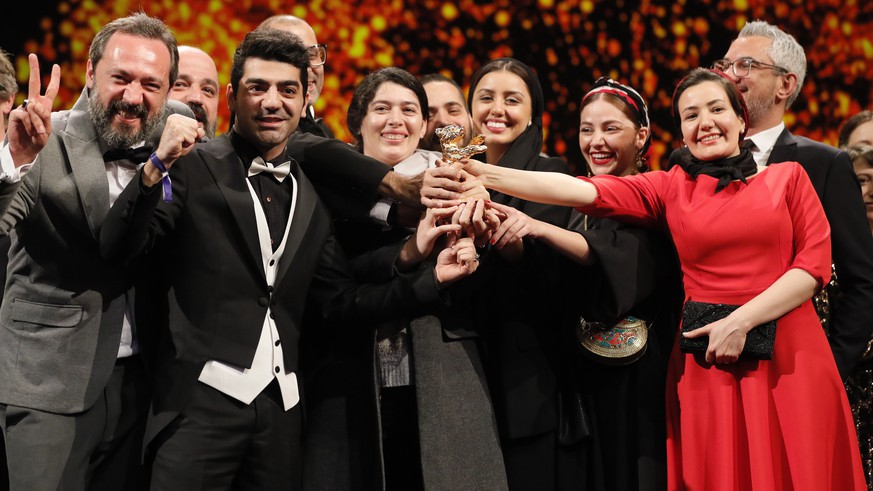 epa08260265 Cast and crew form the movie accepts the Golden Bear on behalf of Mohammad Rasoulof for the movie 'Sheytan vojud nadarad' (There Is No Evil) during the Closing and Awards Ceremony of the 70th annual Berlin International Film Festival (Berlinale), in Berlin, Germany, 29 February 2020. The Berlinale runs from 20 February to 01 March 2020.  EPA/RONALD WITTEK