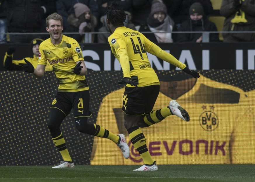 Dortmund's Michy Batshuayi, right, and teammate Andre Schuerrle celebrate the opening goal during the German Bundesliga soccer match between Borussia Dortmund and Hannover 96 in Dortmund, Germany, Sunday, March 18, 2018. (Bernd Thissen/dpa via AP)