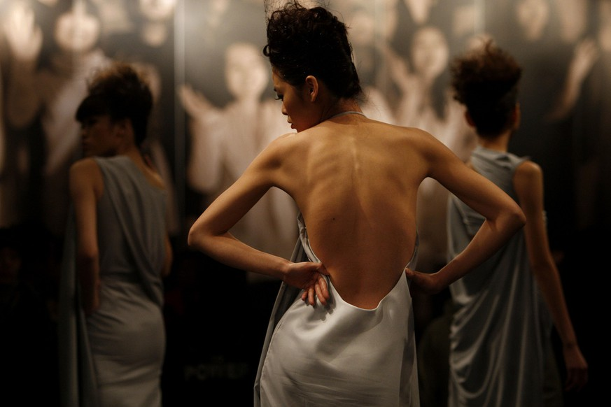 A model wears a creation of China's Central Academy of Fine Arts graduate students, at their 2009 graduation show, presented during China's Fashion Week in Beijing, China, Wednesday, March 25, 2009. (AP Photo/ Elizabeth Dalziel)