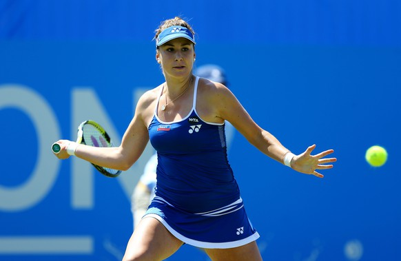 Switzerland's Belinda Bencic in action against Canada's Eugenie Bouchard during day five of the women's international tennis tournament in Eastbourne England Wednesday June 24, 2015. (Gareth Fuller/PA via AP) UNITED KINGDOM OUT  NO SALES NO ARCHIVE