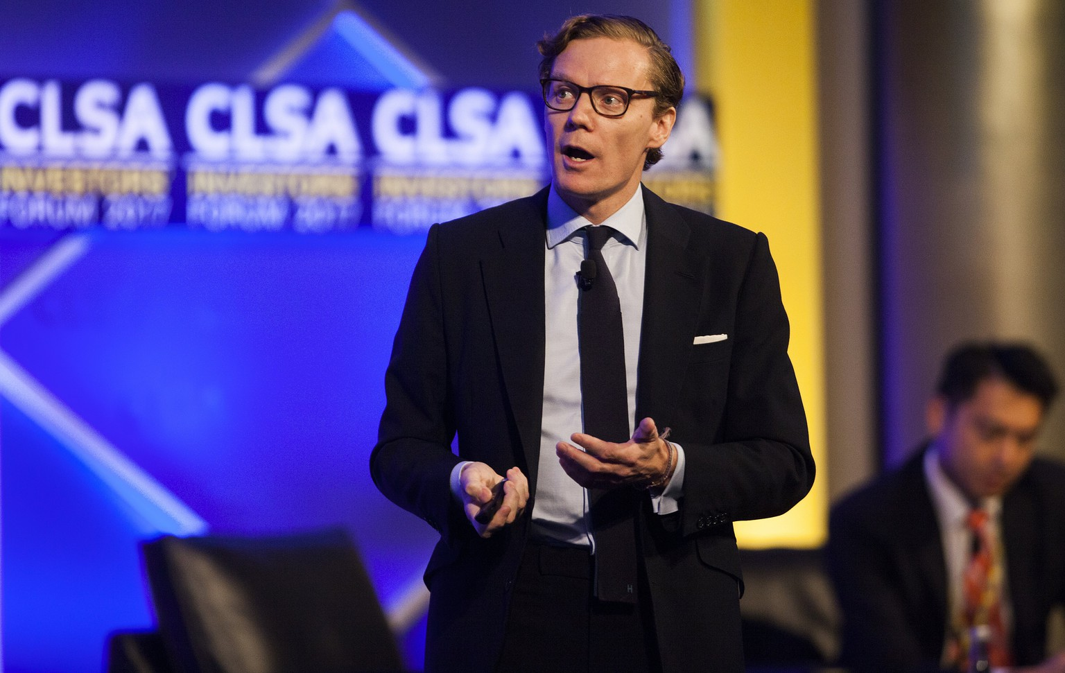 epa06201400 Alexander Nix, CEO of Cambridge Analytica, speaks at the Credit Lyonnais Securities Asia (CLSA) Investors Forum 2017 in Hong Kong, China, 13 September 2017. In 2016, the United States Republican Party hired data analytics and behavioral communications firm Cambridge Analytica to run Donald J. Trump's presidential election campaign using big data and psychological profiling to successfully target undecided American voters in swing states. By using data-driven communications, Cambridge Analytica has been credited with the success of Donald J. Trump's presidential campaign.  EPA/ALEX HOFFORD