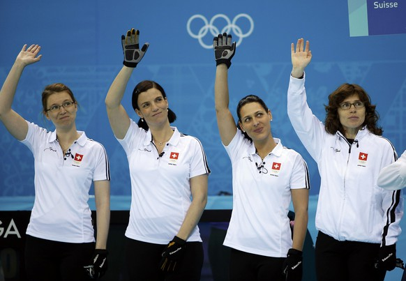 Switzerland's Janine Greiner, Carmen Kueng, Alina Paetz and skip Mirjam Ott (L-R) wave before their women's curling semifinal game against Sweden at the 2014 Sochi Winter Olympics in the Ice Cube Curling Center in Sochi February 19, 2014.   REUTERS/Jim Young (RUSSIA  - Tags: SPORT OLYMPICS SPORT CURLING)