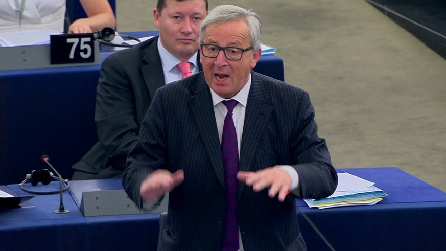 "In this image taken from TV on Tuesday July 4, 2017 EU Commission President Jean-Claude Juncker speaks in the European Parliament in Strasbourg France. Juncker called the legislature ""totally ridiculous"" during a spat over the meager attendance at Tuesday's plenary session. (EBS Via AP)"