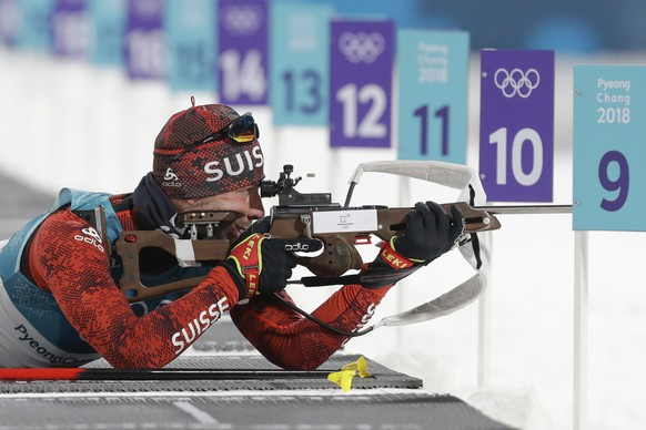 Serafin Wiestner, of Switzerland, shoots from the prone position during the men's 10-kilometer biathlon sprint at the 2018 Winter Olympics in Pyeongchang, South Korea, Sunday, Feb. 11, 2018. (AP Photo/Andrew Medichini)