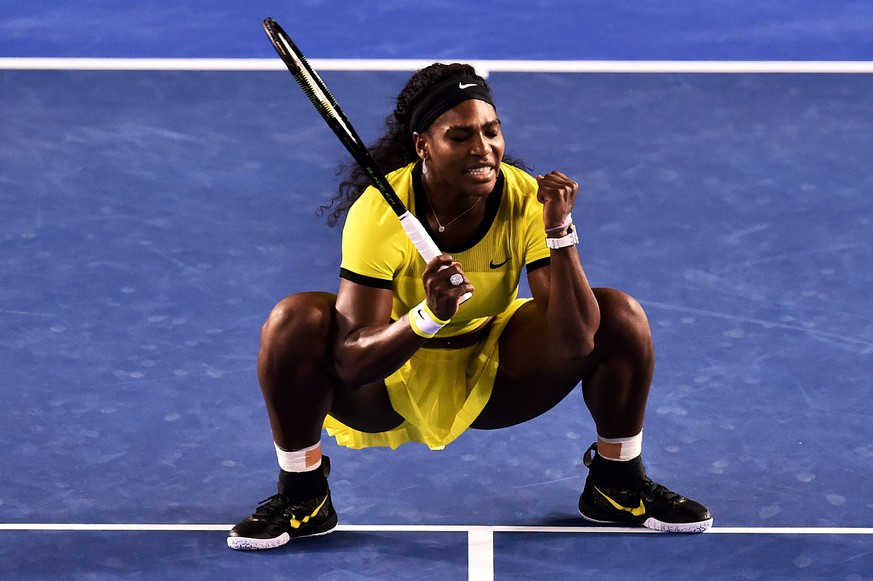 epa05130612 Serena Williams of the US celebrates her win against Agnieszka Radwanska of Poland during their semi finals round on day eleven of the Australian Open tennis tournament in Melbourne, Australia, 28 January 2016.  EPA/JULIAN SMITH AUSTRALIA AND NEW ZEALAND OUT