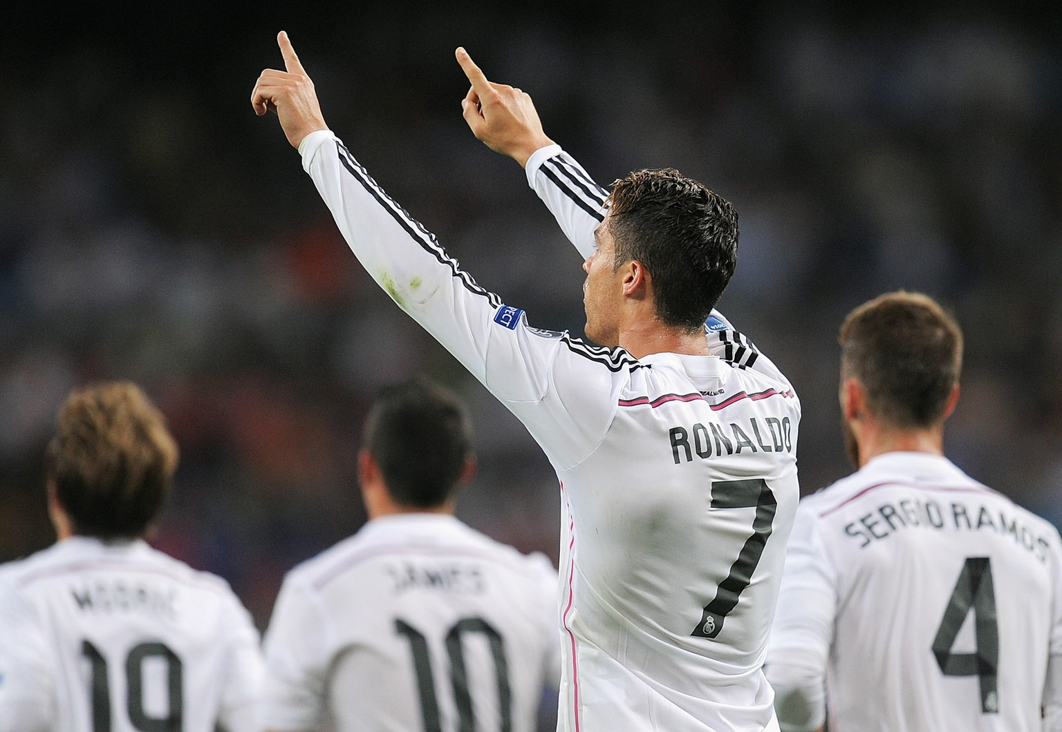 MADRID, SPAIN - SEPTEMBER 16:  Cristiano Ronaldo of Real Madrid celebrates after scoring Real's 3rd goal during the UEFA Champions League Group B match between Real Madrid CF and FC Basel 1893 on September 16, 2014 in Madrid, Spain.  (Photo by Denis Doyle/Getty Images)