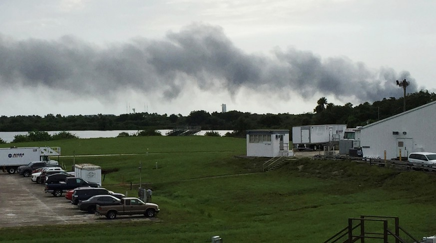 Smoke rises from a SpaceX launch site Thursday, Sept. 1, 2016, at Cape Canaveral, Fla. NASA said SpaceX was conducting a test firing of its unmanned rocket when a blast occurred. (AP Photo/Marcia Dunn)