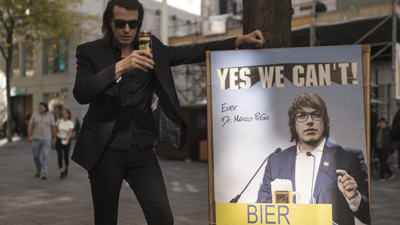 epa08726076 Marco Pogo, singer of Austrian punk rock band Turbobier and leader of the BIER - Bierpartei Oesterreich (Beer Party Austria), poses for photographs next to an elections campaign poster of BIER reading 'Yes we can't' in Vienna, 05 October 2020 (issued 07 October 2020). On the ballots, Viennese will be able to put a cross over BIER, the Austrian Beer Party, which was founded by 33-year-old Austrian singer Marco Pogo in 2015, in the municipal and regional elections on 11 October 2020. BIER would need five per cent to enter the municipal council. According to Pogo, the satiric party can reach one per cent and proposes to convert one of the largest fountains in Vienna into a free beer dispenser and banning Radler, a mixture of beer and lemonade. Pogo, who was a doctor before starting his musical and political career and his BIER party have performed in the Austrian general elections in 2019 and obtained 0.6 percent. He denies that it is a humorous party only and mentions 'Nobody asks the ultra-right wing party if it is a satirical party.' He tries to combine fun and seriousness in politics, 'It is exactly the same with beer consumption, which must be done with responsibility and sense,' he adds. According to local media, BIER leads the election campaigning on social media with a budget of less than 500 Euros. Pogo praises German chancellor Merkel, 'a beer lover who has been pictured with a beer mug,' and says about the US President Trump 'One of his problems is that he doesn't drink beer.'  EPA/CHRISTIAN BRUNA