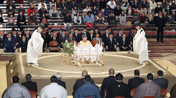 In this Nov. 11, 2017, photo, a Shinto ceremony is held to pray for the safety of sumo wrestlers before the start of the Kyushu Grand Sumo tournament in Fukuoka, southwestern Japan. Nobuyoshi Hakkaku, head of the Japan Sumo Association, apologized Wednesday, April 4, 2018 over an incident in which women first responders were asked to get out of the ring as they attempted to revive an official who collapsed in Maizuru, western Japan. In sumo's tradition, the ring is considered sacred and women are prohibited from entering. (Kyodo News via AP)