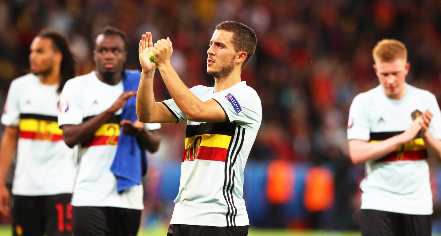 epa05402494 Eden Hazard (C) of Belgium and his teammates applaud fans after the UEFA EURO 2016 quarter final match between Wales and Belgium at Stade Pierre Mauroy in Lille Metropole, France, 01 July 2016. Wales won 3-1.