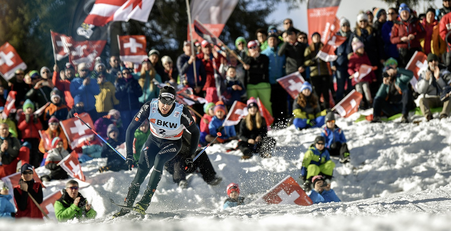 Dario Cologna of Switzerland skis to win the men's 15 kilometer cross country pursuit race at the Tour de Ski in Lenzerheide, Switzerland, Monday, Jan. 1, 2018. (Peter Schneider/Keystone via AP)