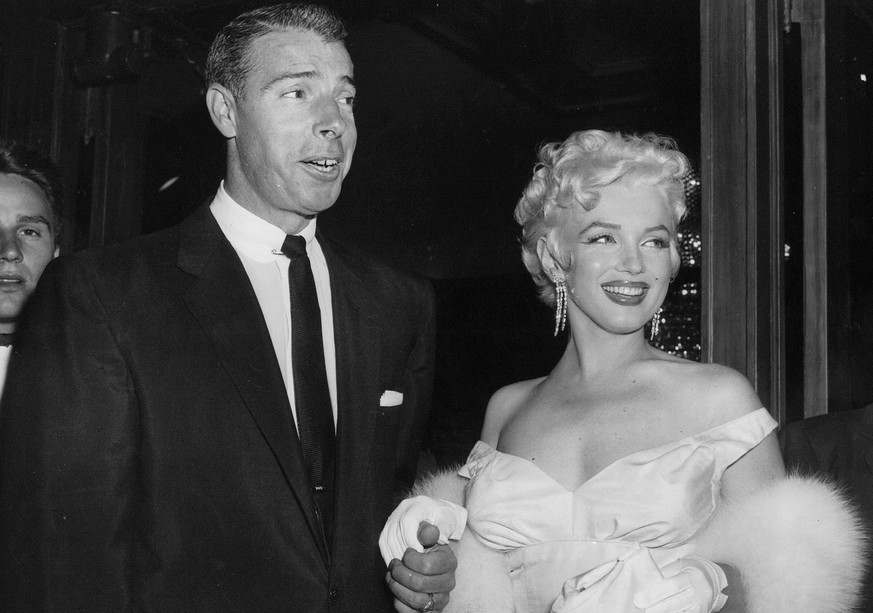 FILE - In this June 2, 1955 file photo, actress Marilyn Monroe, right, dressed in a glamorous evening gown, arrives with Joe DiMaggio at the theater. Monroe's Lost Archives are coming to light now, along with a cache of other Monroe memorabilia that the Beverly Hills auction house Julien's is putting up for sale on Dec. 5-6, 2014. Along with the letters from  DiMaggio, Miller and such Hollywood luminaries as Cary Grant and Jane Russell are some of the actress' favorite clothes, photographs, paintings and other keepsakes. (AP Photo, File)