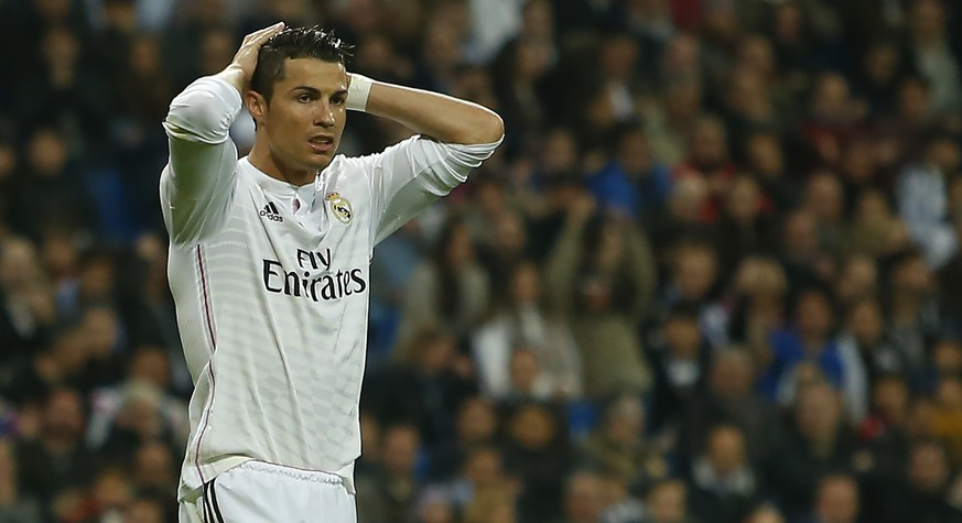 Real Madrid's Cristiano Ronaldo gestures during a Spanish La Liga soccer match between Real Madrid and Villarreal at the Santiago Bernabeu stadium in Madrid, Spain, Sunday, March 1, 2015. (AP Photo/Andres Kudacki)