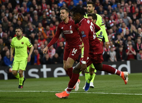 epa07554445 Divock Origi (C) of Liverpool scores the opening goal during the UEFA Champions League semi final 2nd leg match between Liverpool FC and FC Barcelona at Anfield, Liverpool, Britain, 07 May 2019.  EPA/NEIL HALL
