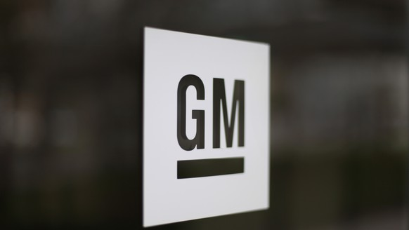 FILE - This May 16, 2014, file photo, shows the General Motors logo at the company's world headquarters in Detroit. Under pressure from the federal government, General Motors is recalling more than 3.4 million big pickup trucks and SUVs in the U.S to fix a brake problem. The recall covers the Chevrolet Silverado and GMC Sierra 1500, 2500 and 3500 pickups from the 2014 through 2018 model years. GM says a pump in the power-assist brakes can put out less vacuum than needed, increasing stopping distance and the risk of a crash. (AP Photo/Paul Sancya, File)General Motors,GM