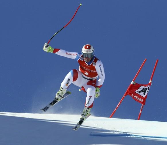 Switzerland's Beat Feuz competes in an alpine ski, men's World Cup Super G race, in Kitzbuehel, Austria, Friday, Jan. 20, 2017. (AP Photo/Alessandro Trovati)