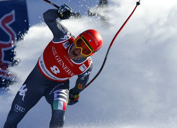 Italy's Christof Innerhofer reacts after completing an alpine ski, men's World Cup Super G, in Kitzbuehel, Austria, Friday, Jan. 20, 2017. (AP Photo/Giovanni Auletta)