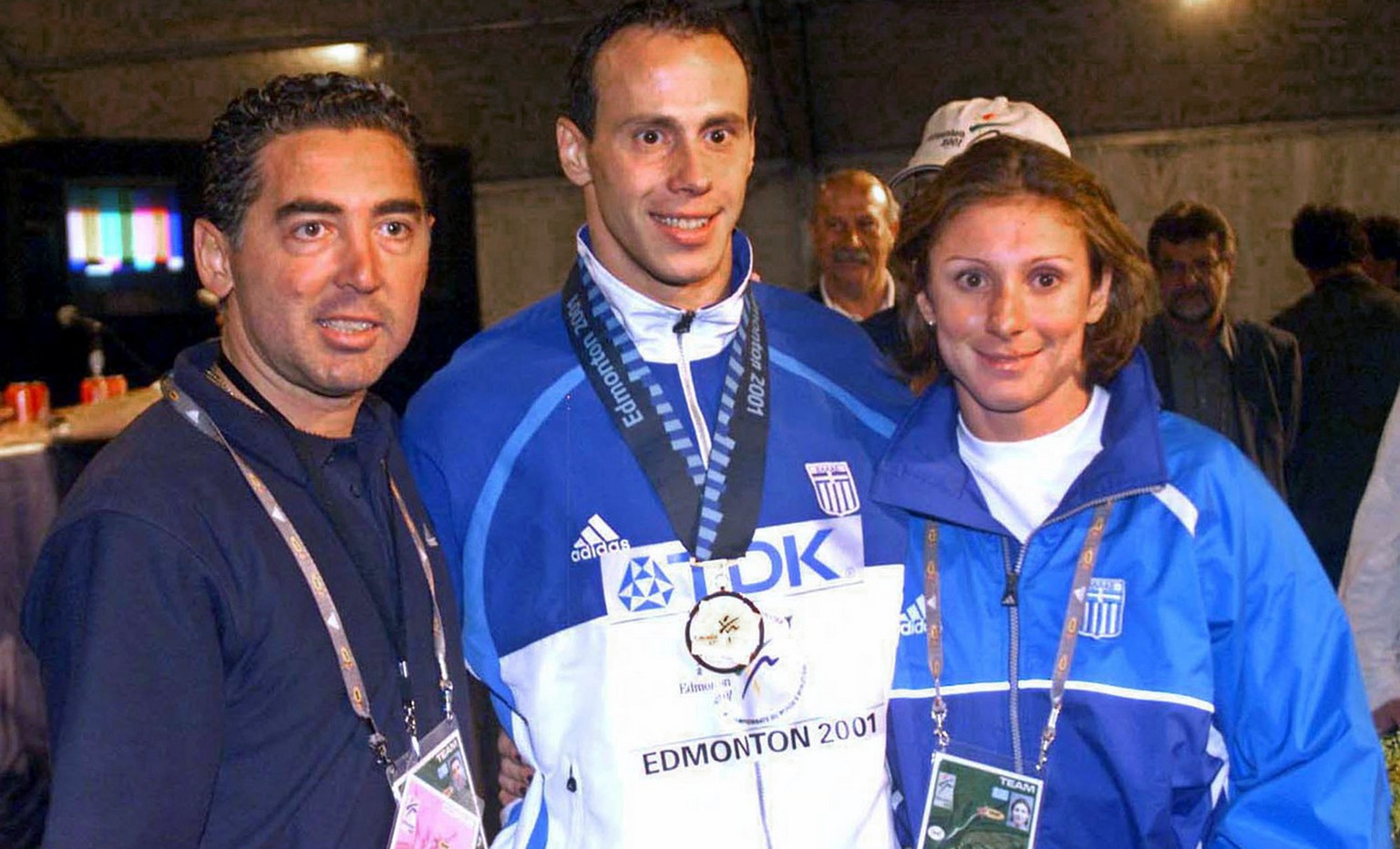 This is an August 9, 2001 photo of Greek athletes Konstantinos Kenteris, center, and Katerina Thanou, the 100-meter silver medalist in Sydney, right with their coach Christos Tsekos taken at the World Championships in Edmonton, Canada. The two Greek Olympic sprinters were hospitalized Friday, Aug. 13, 2004 with injuries from a motorcycle wreck hours before a hearing on whether they intentionally dodged drug testers. (AP Photo/Newsport)