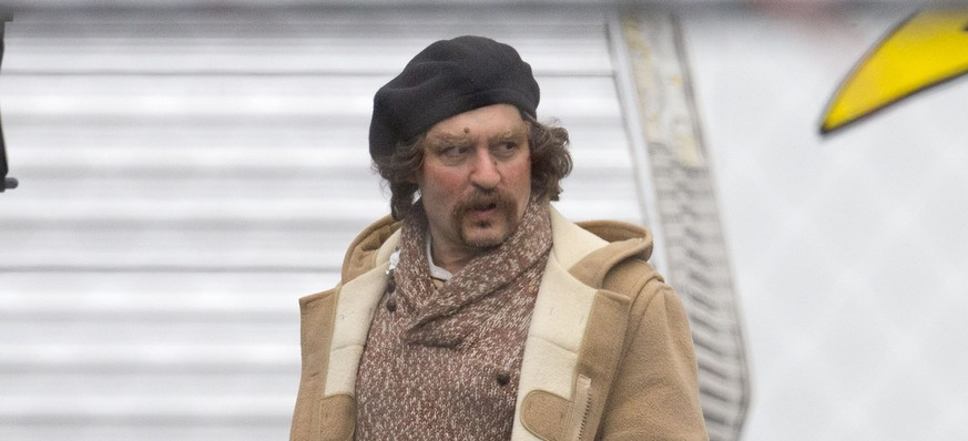 EXCLUSIVE: **PREMIUM RATES APPLY** Johnny Depp looks unrecognizable in costume on the set of 'Yoga Hosers' in Los Angeles. The heart throb appears to have gained weight for the role as he was spotted dressed as an older gentleman, complete with goatee, facial warts and carrying an electronic cigarette. Depp 51, stars in the Kevin Smith directed movie alongside his daughter Lily-Rose Melody Depp and Smith's daughter Harley Quinn Smith. 