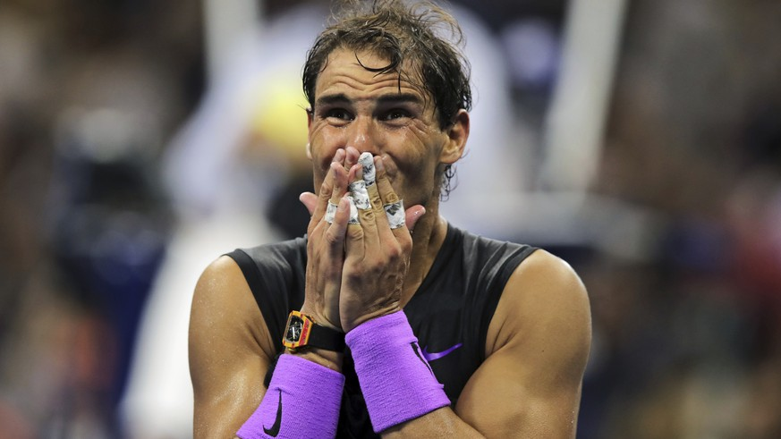 Rafael Nadal, of Spain, reacts after defeating Daniil Medvedev, of Russia, to win the men's singles final of the U.S. Open tennis championships Sunday, Sept. 8, 2019, in New York. (AP Photo/Charles Krupa)