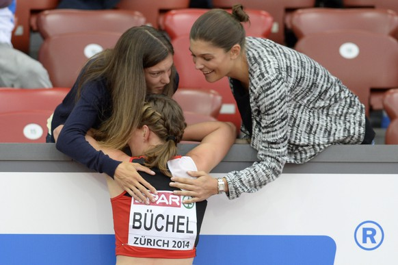 Selina Buechel from Switzerland is comforted after reaching 4th place in the women's 800m semifinal race, at the third day of the European Athletics Championships in the Letzigrund Stadium in Zurich, Switzerland, Thursday, August 14, 2014. (KEYSTONE/Jean-Christophe Bott)