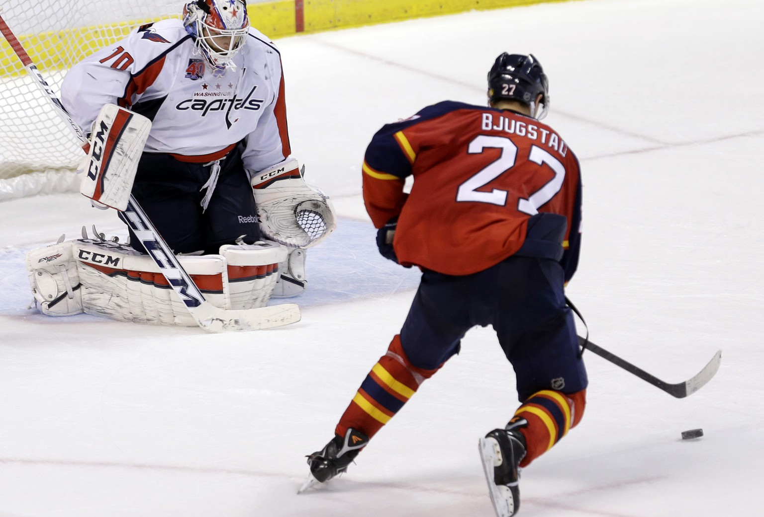 Florida Panthers center Nick Bjugstad (27) prepares to score against Washington Capitals goalie Braden Holtby (70) in the 20th round of a shootout, the longest shootout in the history of an NHL hockey game, in Sunrise, Fla., Tuesday, Dec. 16, 2014. The Panthers won 2-1. (AP Photo/Alan Diaz)