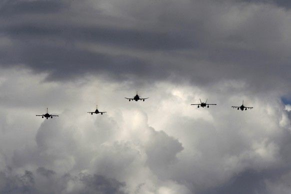 epa09147341 Aircrafts fly during the multinational exercise 'INIOCHOS 2021' at the Andravida Air Base, Northwest Peloponnese, Greece, 20 April 2021. The 'INIOCHOS' exercise is an annual medium scale exercise (type INVITEX) based on the facilities of the AIR TACTICS CENTER. In 'INIOCHOS 2021' are participating: France with Rafale and ?-2000D, USA with F-16, MQ-9 and KC-135, UAE with F-16, Spain with F/A-18 Hornet, Israel with F-15 and F-16, Cyprus with helicopter AW139, according to Hellenic Air Force.  EPA/ALEXANDROS VLACHOS