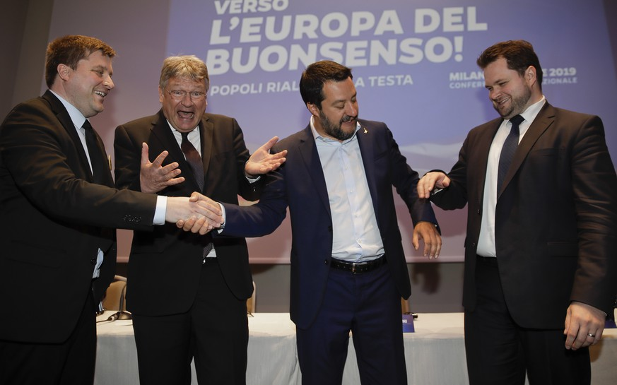 From left, Olli Kotro, leader of The Finns Party, Jörg Meuthen, leader of Alternative For Germany party, Matteo Salvini, Italian deputy-Premier and leader of the League party, and Anders Vistisen, leader of the Danish People's Party, join hands prior to the start of a press conference, in Milan, Monday, April 8, 2019. Salvini, Italy's hard-line vice Premier, is meeting with like-minded leaders of European right-wing party as he seeks to form a broad alliance ahead of the European elections next month. (AP Photo/Luca bruno)