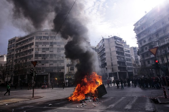 ATHENS, GREECE - FEBRUARY 12:  Greek farmers burn a garbage container during a protest against planned pension reforms outside the Agriculture ministry on February 12, 2016 in Athens, Greece. Around reportedly 800 protesters from Crete gathered outnumbering police who were armed with teargas.  (Photo by Milos Bicanski/Getty Images)