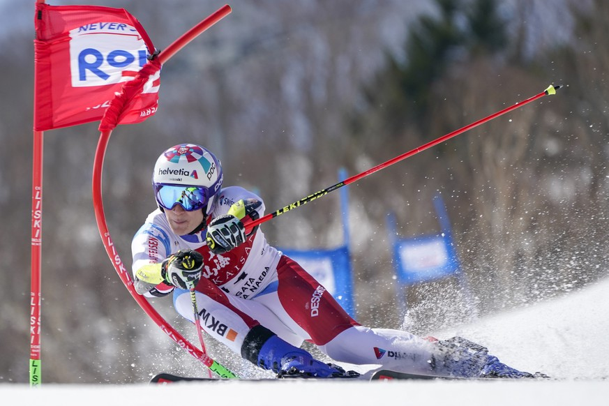 Marco Odermatt of Switzerland competes in the men's giant slalom during the FIS Alpine Ski World Cup at Naeba Ski Resort in Yuzawa, Niigata prefecture, northern Japan, Saturday, Feb. 22, 2020. (AP Photo/Christopher Jue)