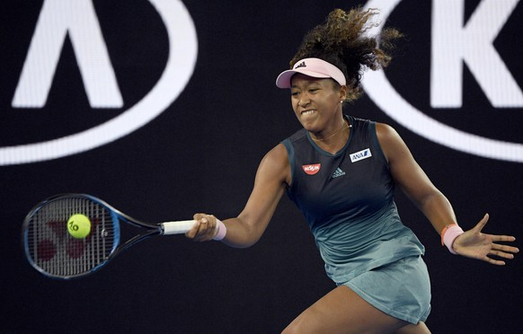 JapanÅfs Naomi Osaka makes a forehand return to SloveniaÅfs Tamara Zidansek during their second round match at the Australian Open tennis championships in Melbourne, Australia, Thursday, Jan. 17, 2019. (AP Photo/Andy Brownbill)