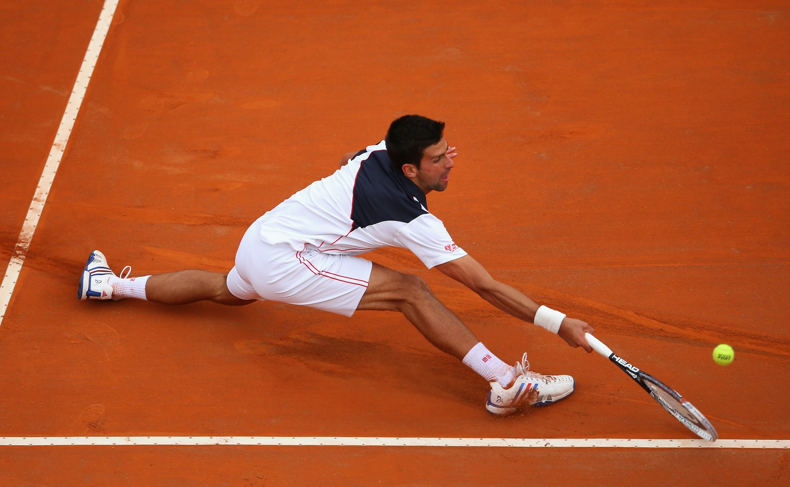 ROME, ITALY - MAY 16:  Novak Djokovic of Serbia in action against David Ferrer of Spain during day six of the Internazionali BNL d'Italia tennis 2014 on May 16, 2014 in Rome, Italy.  (Photo by Julian Finney/Getty Images)
